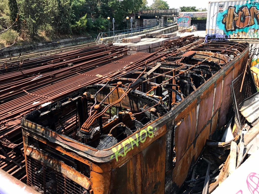 burned carcass of train car in athens railway