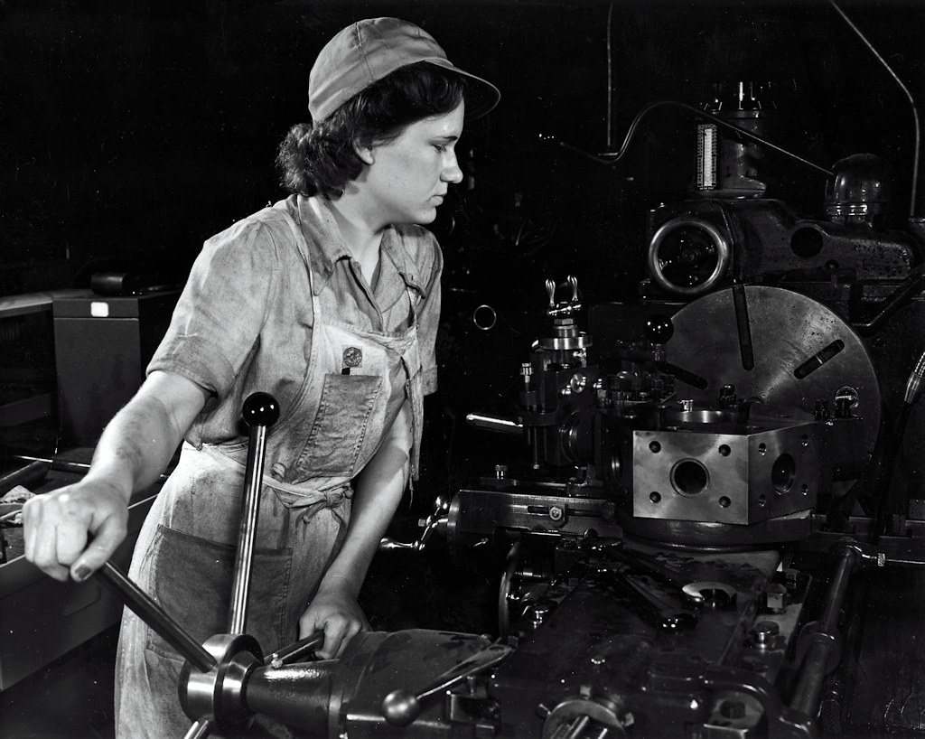 Grace Janota, former department store clerk, is now a lathe operator at a Western aircraft plant producing B-24 bombers and C-87 transports. October 1942