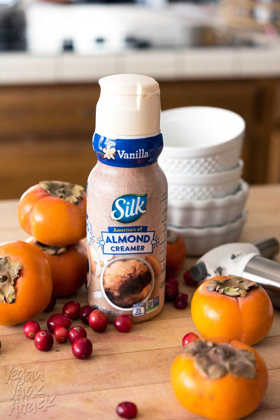 Looking for a stunning holiday dessert that is easy-to-make? Check out this impressive, vegan Persimmon Crème Brûlée with Sugared Cranberries! Made with Silk's Vanilla Almond Creamer. #SilkCreamer #glutenfree #soyfree
