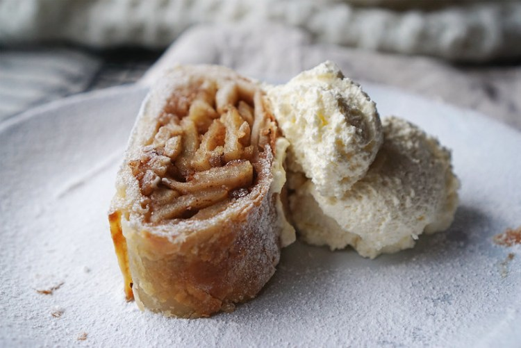 Gluten free apple and walnut strudel with a dusting of icing sugar and hazelnut flavoured whipped cream | made with Jus-Rol gluten free puff pastry