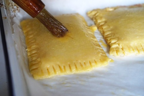 Homemade gluten free pop tarts | adding egg wash with a pastry brush