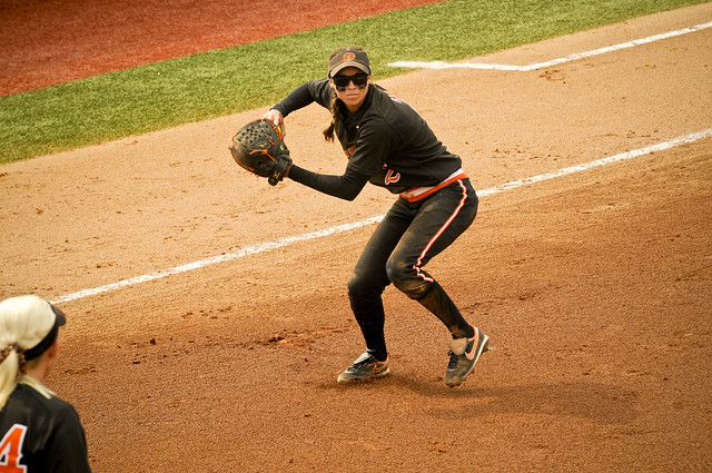 Mariah Gearhart throws to first base