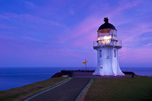 Cape Reinga Lighthouse At Sunrise The Lighthouse Is