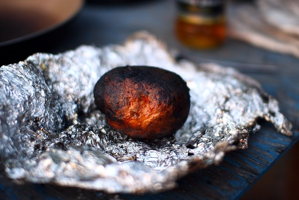 Campfire Baked Potato A Little Burnt On The Outside A
