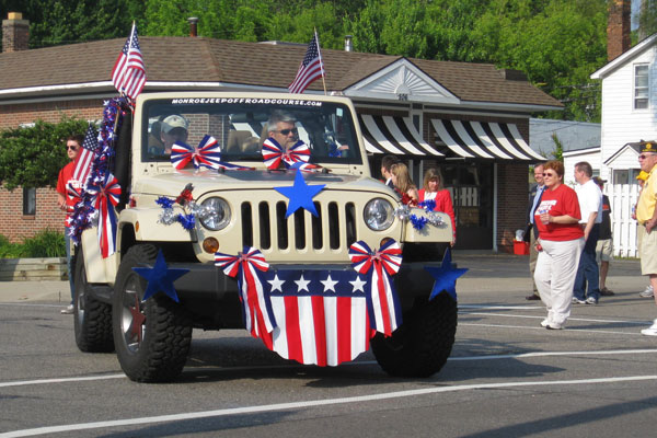 Jeep decorated with patriotic red, white, and blue decorations