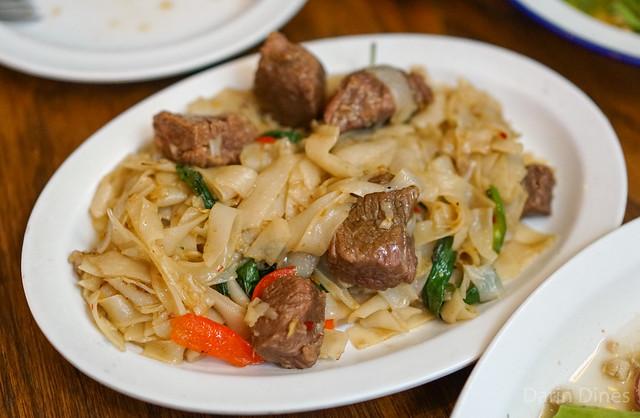 pad kee mao drunken noodles with sliced short rib, chile, thai basil, garlic