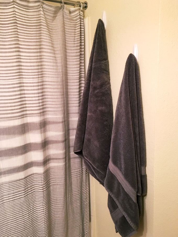 grey shower curtain and towels