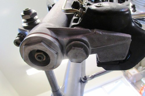 Bottom of Left Fork Showing Cover Bolt for Brake Caliper Eccentric Pin