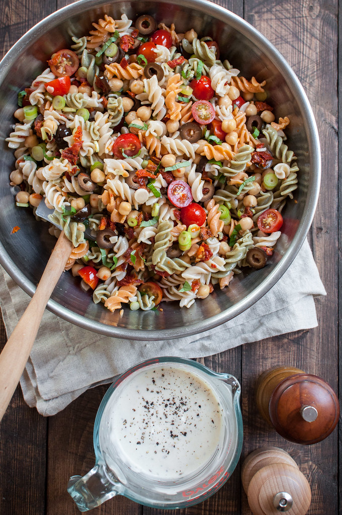 Creamy pasta salad with fresh and sun dried tomatoes, big Italian flavor, and NO gluten, dairy, or eggs!