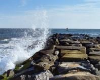 Photo of wave crashing on jetty