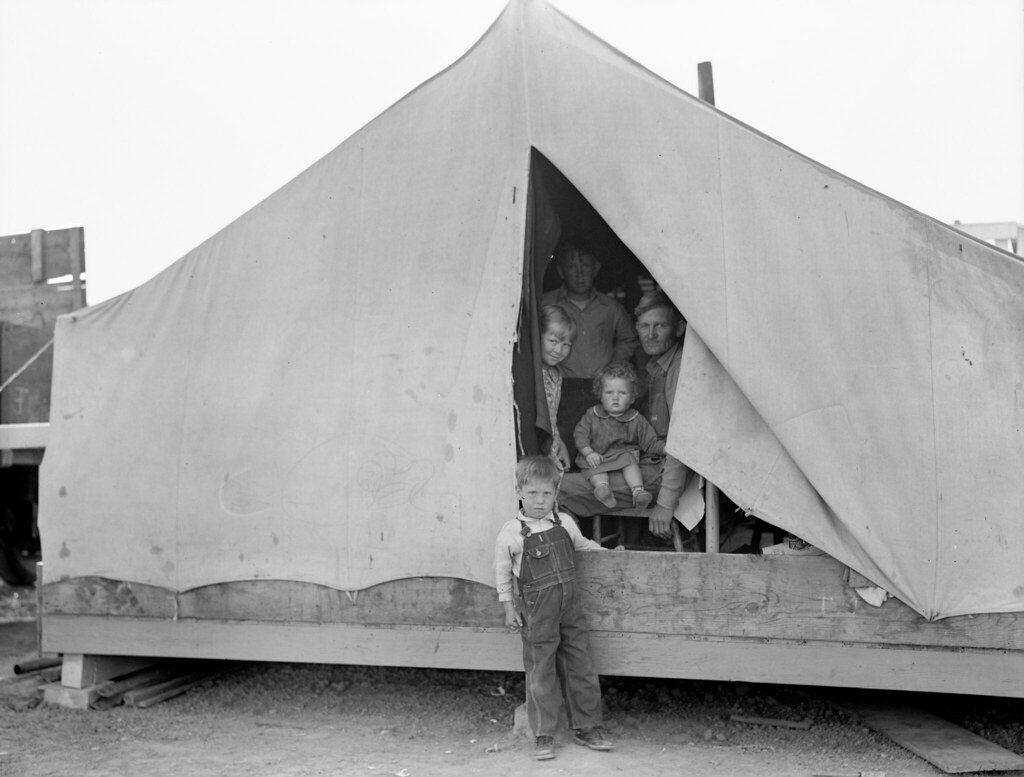 Tent of Family of mother, father and eleven children. Brawley, Imperial Valley. In Farm Security Administration FSA migratory labor camp. Dorothea Lange (photographer) February 1939