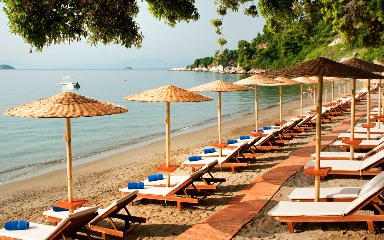 Vasilias beach is equipped with Umbrellas and Sun-beds