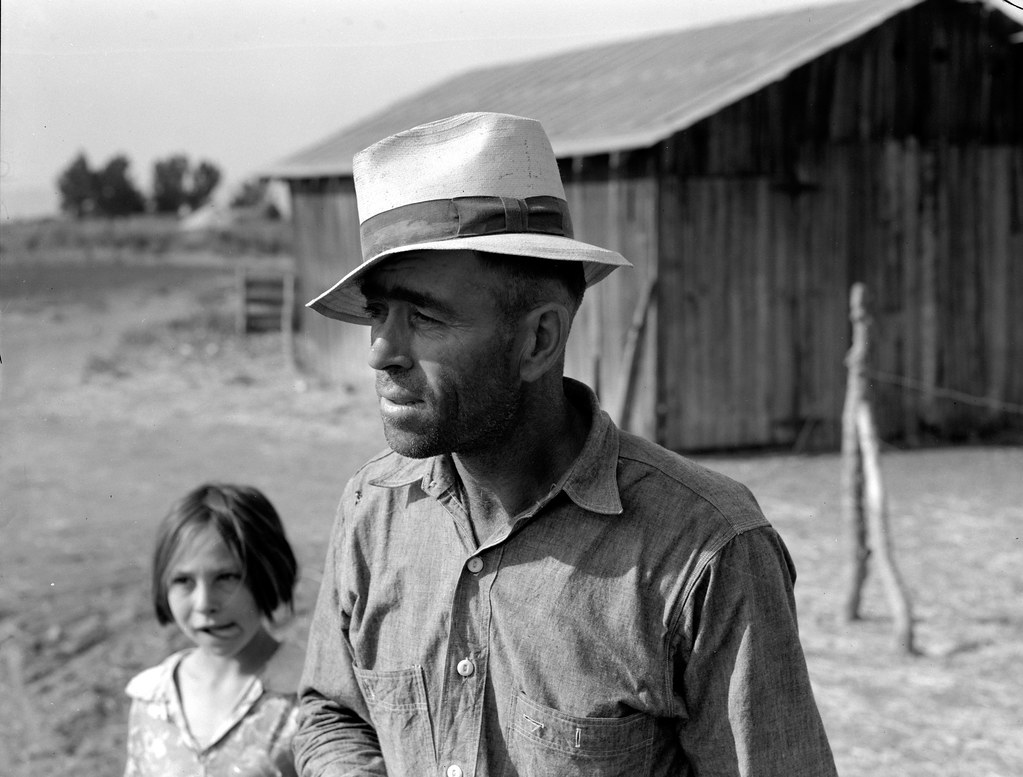 Chris Adolf and his daughter, Lois, who is just being a kid. Yakima Valley, Washington. Farm of Rehabilitation Administration borrower.