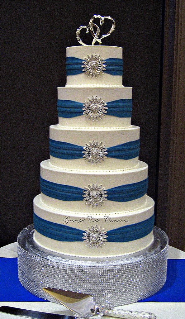 Elegant White Buttercream Wedding Cake with Royal Blue Sas      Flickr     Elegant White Buttercream Wedding Cake with Royal Blue Sashes and  Silver Brooches   by Graceful Cake