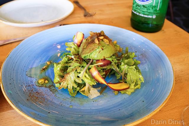 CHARRED AVOCADO shaved vegetables / pistachio / ash / kale