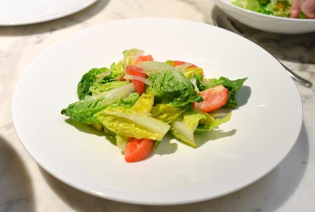ensalada mixta, lettuce, onions, tomatoes.