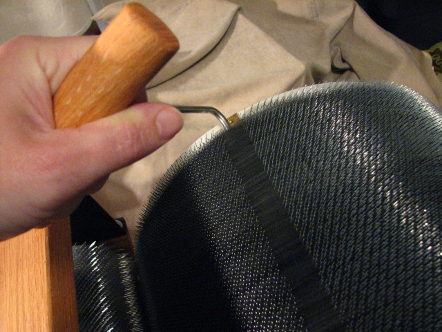 Removing a batt from a drum carder