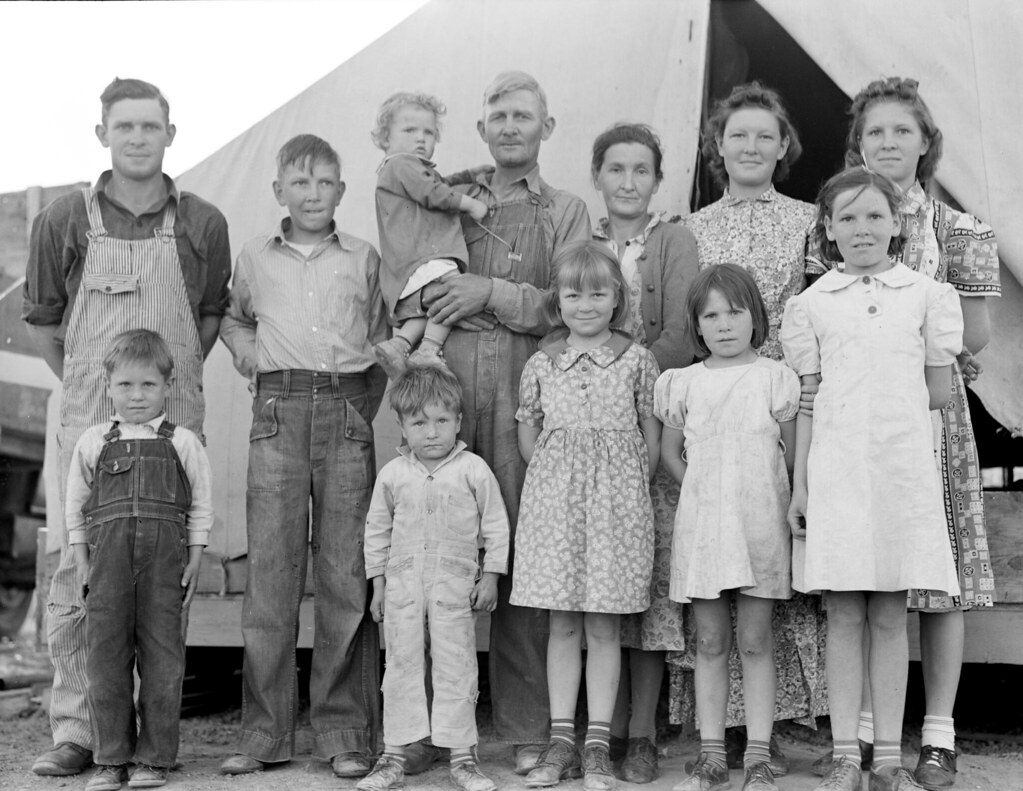 """Lange, Dorothea, photographer. In Farm Security Administration FSA migrant labor camp during pea harvest. Family from Oklahoma with eleven children. Father, eldest daughter and eldest son working. She: """"I want to go back to where we can live happy, live decent, and grow what we eat."""" He: """"I've made my mistake and now we can't go back. I've got nothing to farm with."""" Brawley, Imperial County, California. Feb, 1939."""