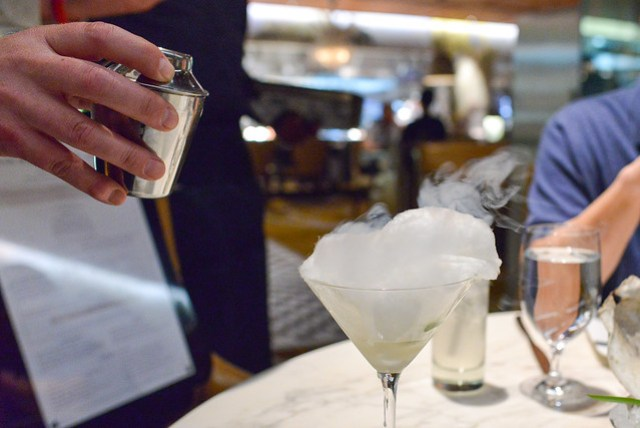 """""""Magic"""" Mojito served in an individual shaker strained over cotton candy"""