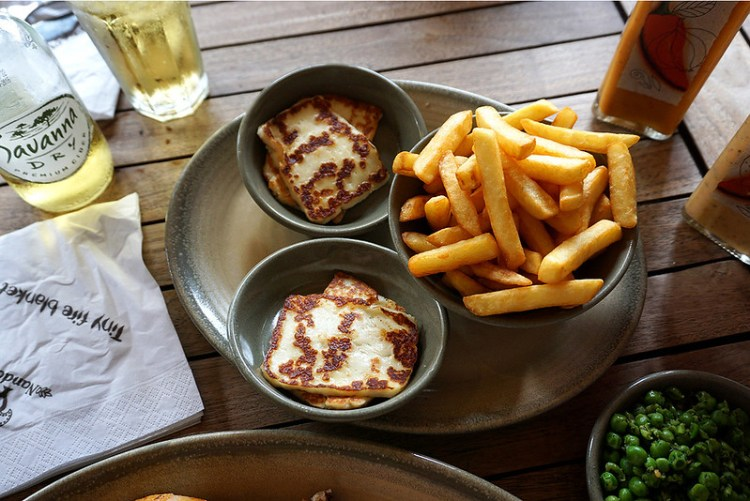 Grilled halloumi, chips, macho peas and Savana Dry cider from Nando's | Gluten free Notting Hill guide | Kensington | Bayswater | Ladbroke Grove | Portobello Market | West London | Gluten free London restaurants