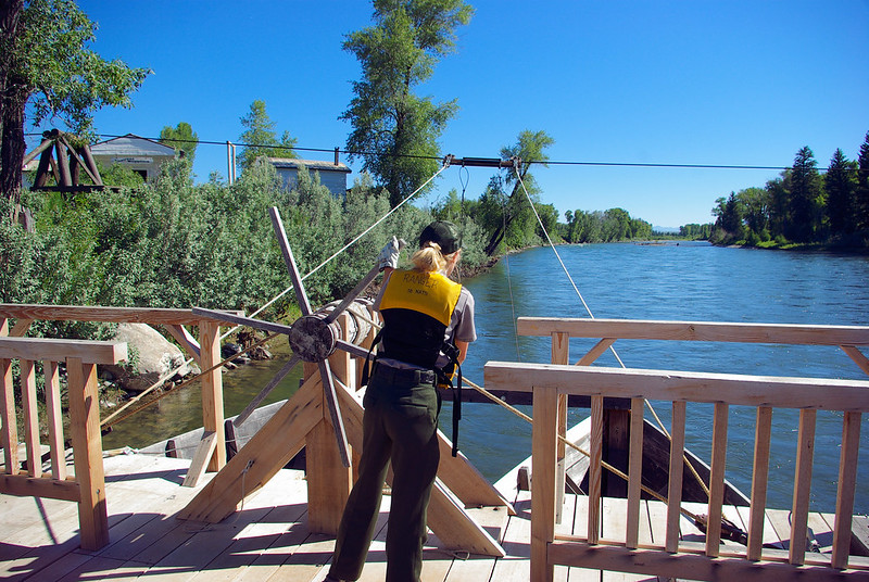 National Park Service interpretive ranger operating Menor's Ferry, Grand Teton National Park, Wyoming