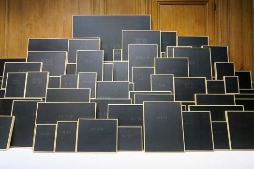 black paintings w names/numbers