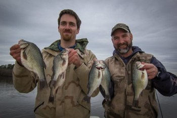 Photo of two men holding white perch