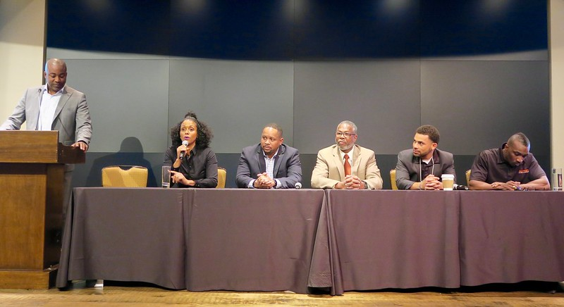 Leonard Moore moderates a panel with Thais, Darren, Louis, Devin, and MJ