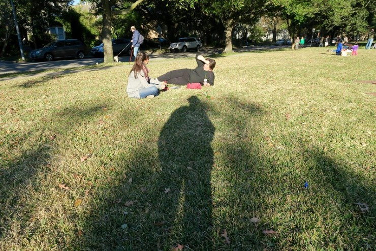 Maile and Ellyn, lounging on the grass above my approaching shadow