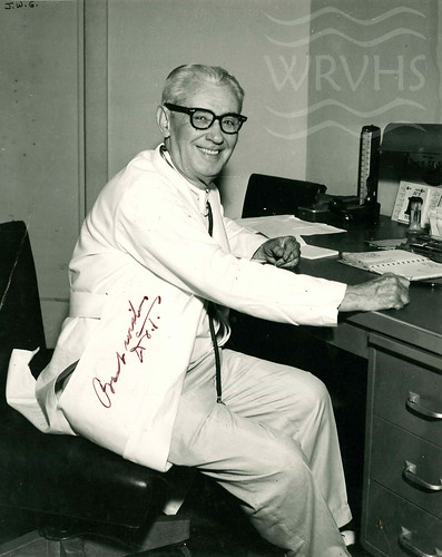 Dr. J. M. Threadgill sitting at his desk