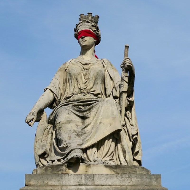 statues throughout the city had been secretly blindfolded in scarlet
