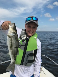Photo of boy holding striped bass