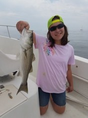Photo of Girl holding striped bass
