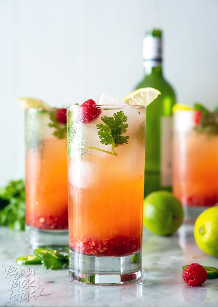 This Pineapple Raspberry Wine Spritzer is perfect for keep you cool during these hot summer months! Sweet pineapple, tart raspberry, plus fresh herbs, white wine, and sparkling water; does it get any better? #vegan #spritzer #beverage