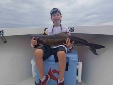 Boy holding his cobia catch