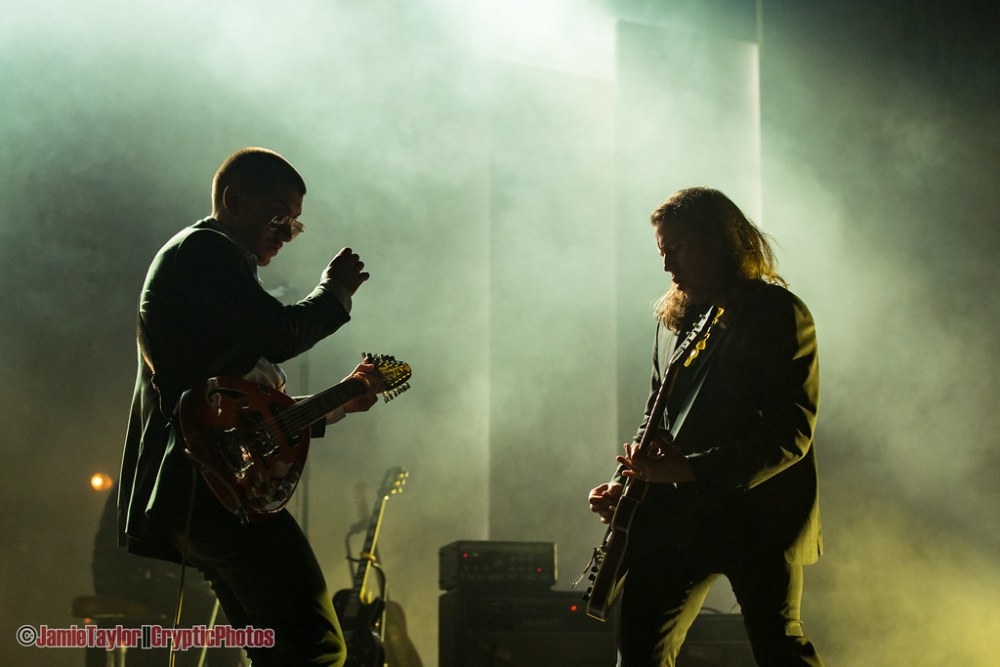 Guitarist Jamie Cook and singer Alex Turner of Arctic Monkeys performing at Pacific Coliseum in Vancouver, BC on October 25th, 2018