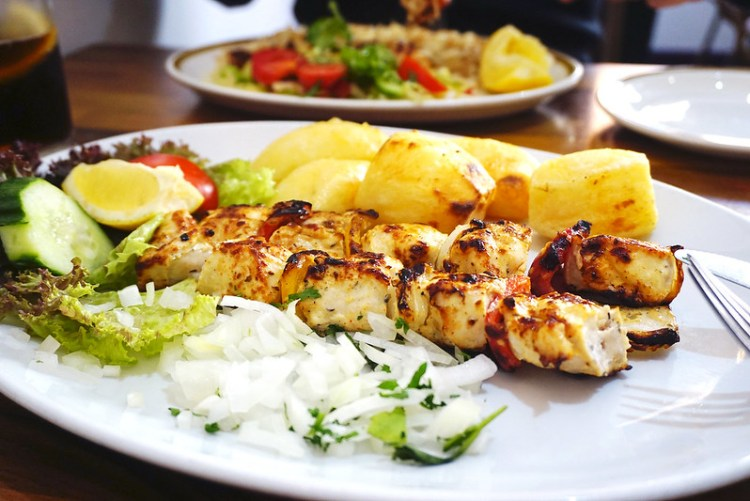Chicken kebab, roasted potatoes, salad and onion & parsley garnish from Apollo, a Cypriot restaurant in Finsbury Park/Holloway | My Gluten Free Finsbury Park Guide | Stroud Green | North London