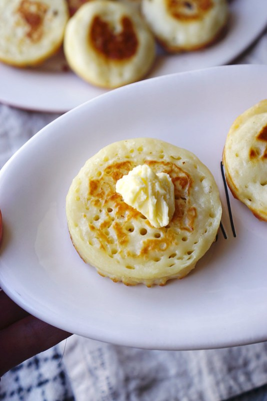 Homemade gluten free crumpets with butter