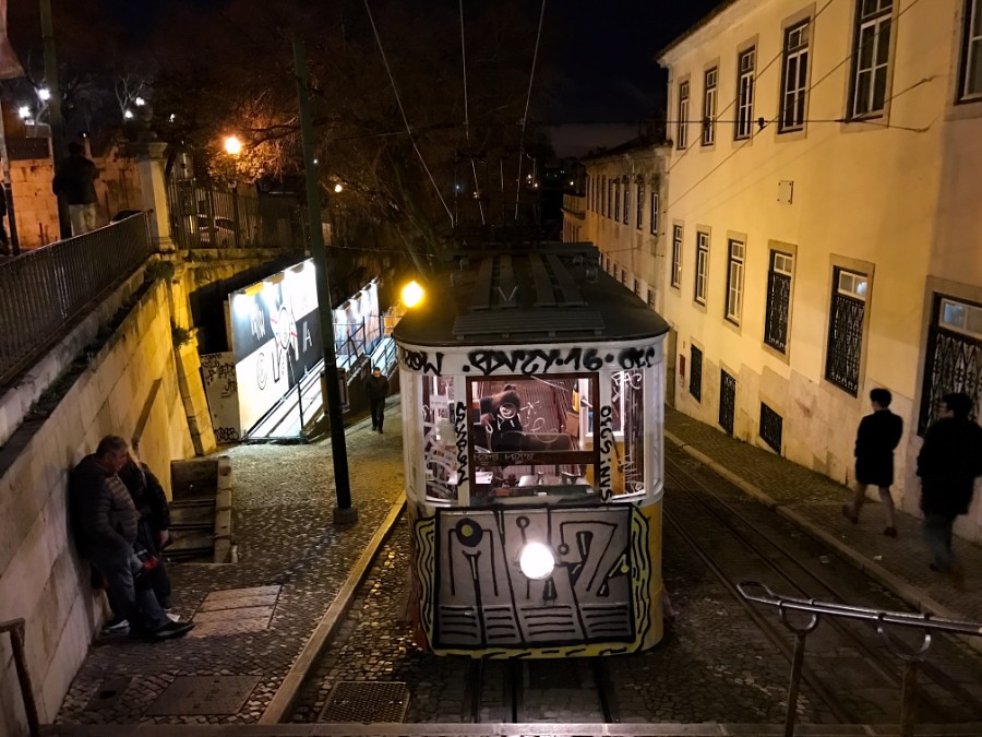 painted tram coming up steep road in lisbon