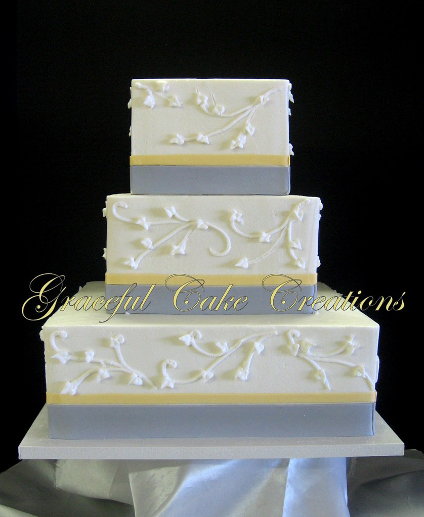 Elegant White Butter Cream Wedding Cake With Gray And Yell