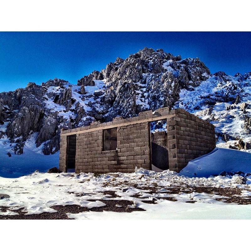 concrete brick hut on mount helicon - climb mount helicon