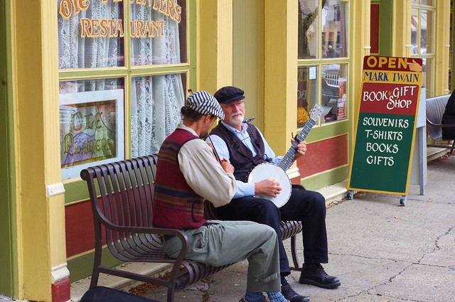 "A couple of musicians on a bench in Hannibal, Missouri, (Mark Twain's ""home town"") September 27, 2012"
