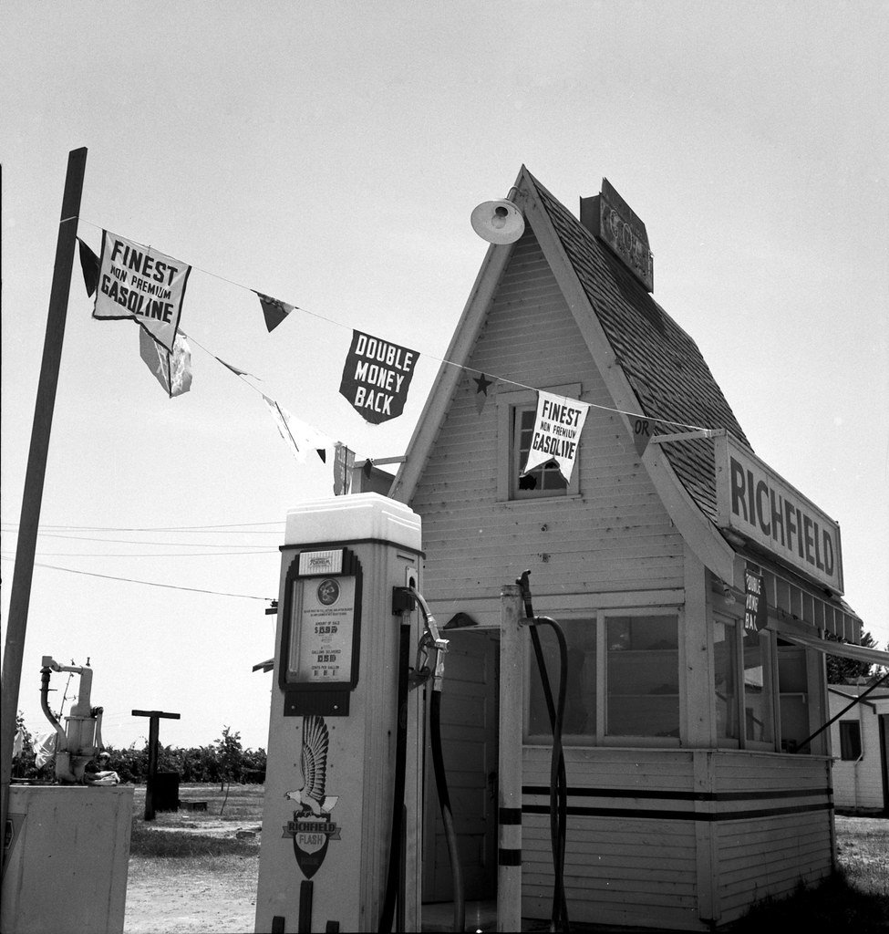 1939 California Service Station -- Between Tulare and Fresno on U.S. 99. A large variety and great number of service stations face highway.