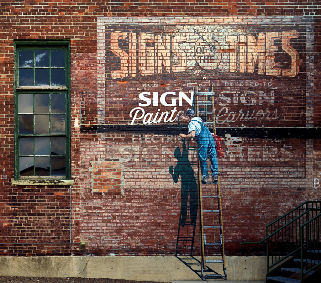 "Signs of the Times -- An elaborate painted sign, of four completed in three days in 2015 by ""lettermen,"" as artistic sign painters call themselves, who met for a convention in Cincinnati, Ohio, and stopped by the American Sign Museum in the industrial Camp Washington neighborhood to see the museum and demonstrate their trade."