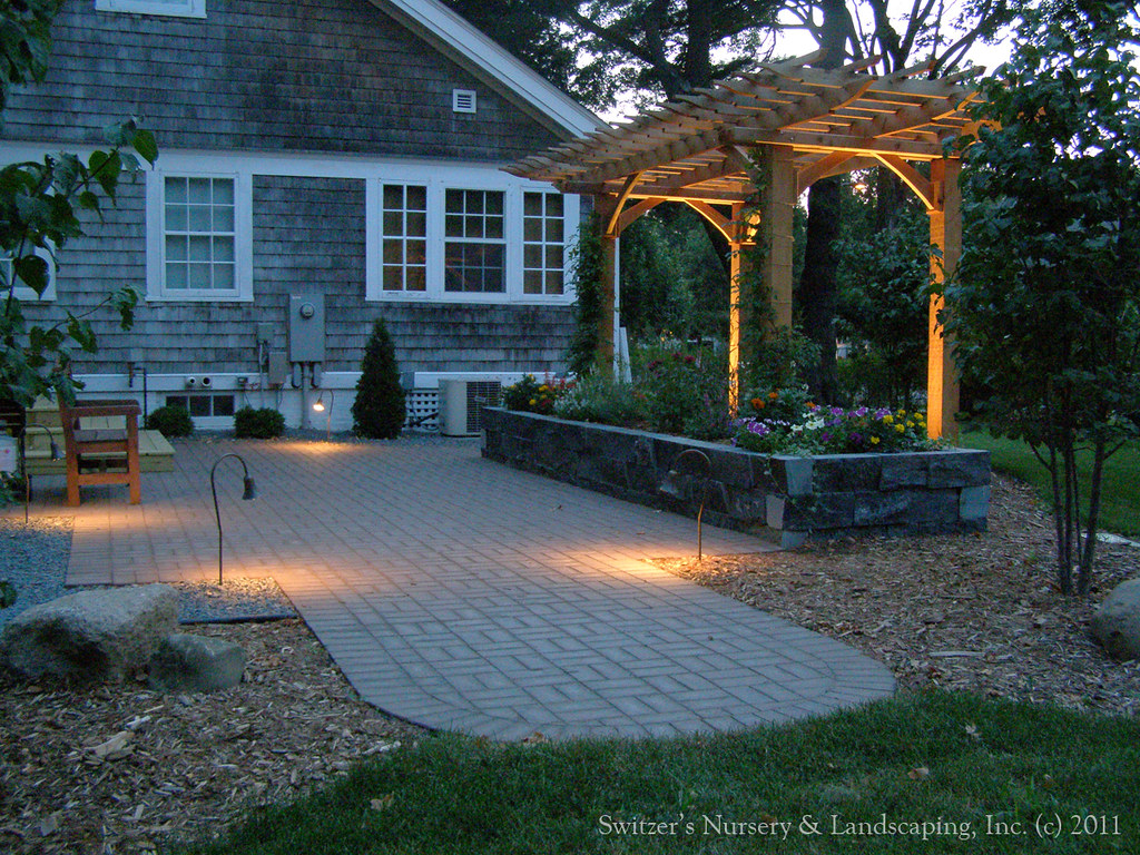 Clay Paver Dinning Patio With Natural Stone Raised Planter