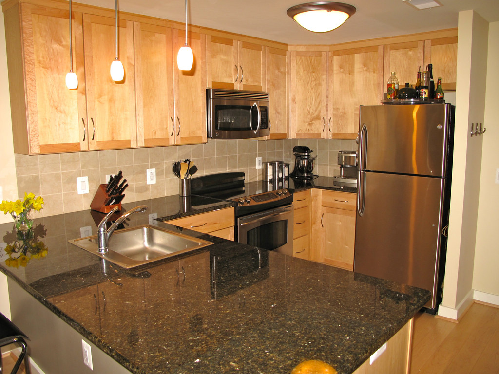 Granite Counter Tops,Maple Cabinets and Stainless Steel Ap ... on Maple Kitchen Cabinets With Black Granite Countertops  id=86488