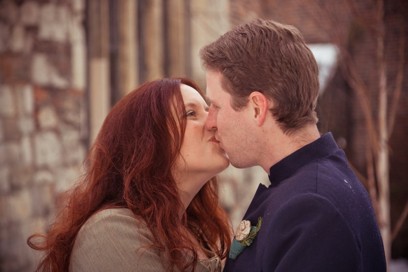 Kissing by the reception hall