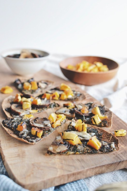 Kale pesto tortilla pizza with mushrooms and roasted delicata squash