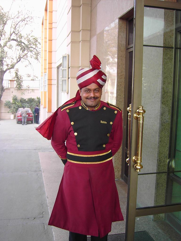 Smiling Turban Headed Door Man At An Indian Hotel In Varan