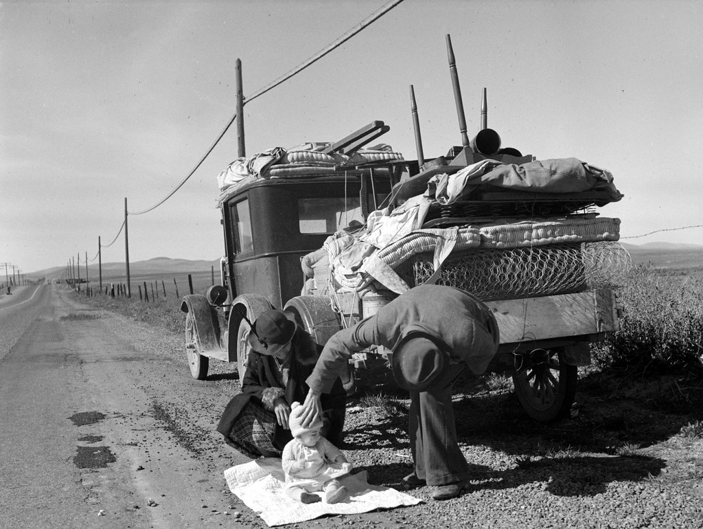 Missouri family of five, seven months from the drought area, on U.S. Highway 99 near Tracy, California. February 1937; photo by Dorothea Lange; Library of Congress image.